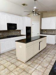 white cabinets edited with beige island.jpg