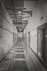 Kilmainham Gaol prison cell hallway with partial metal grid floors- Dublin Ireland - Sepia_0.jpg